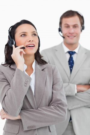 Call center agents standing together against a white background photo