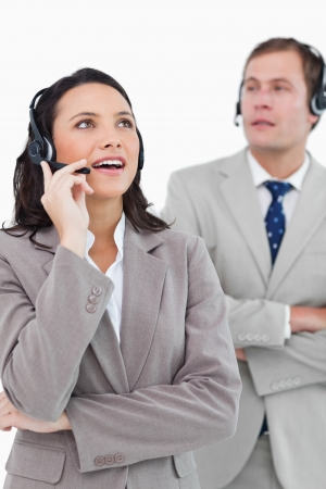 Call center agents at work against a white background photo