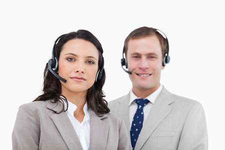 Young call center agents standing together against a white background photo
