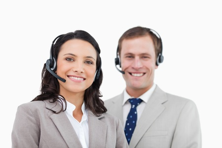 Smiling call center agents standing together against a white background photo