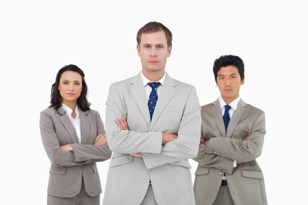 Confident young businessteam against a white background Stock Photo - 13605896