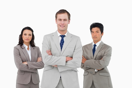 Confident young businessteam with arms folded against a white background Stock Photo - 13606005