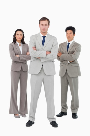 Serious young businessteam standing together against a white background photo