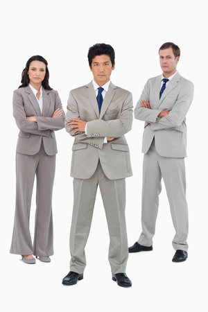 Young businessteam with folded arms against a white background Stock Photo - 13605051