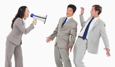loss leader: Businesswoman with megaphone shouting at colleagues against a white background