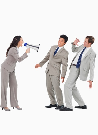 Saleswoman with megaphone yelling at colleagues against a white background photo