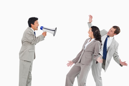 Salesman with megaphone yelling at colleagues against a white background photo