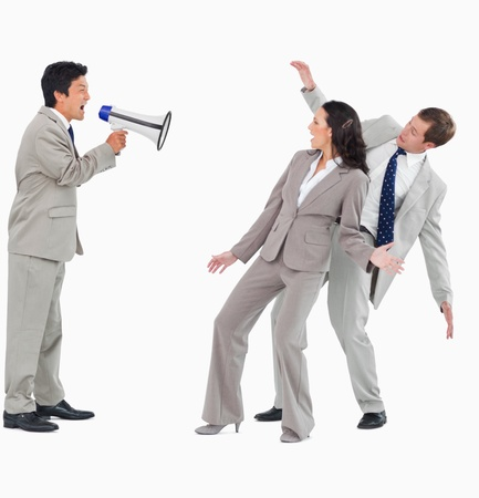 Businessman with megaphone shouting at colleagues against a white background Stock Photo - 13600364