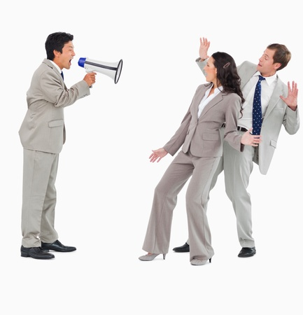 loss leader: Salesman with megaphone shouting at colleagues against a white background