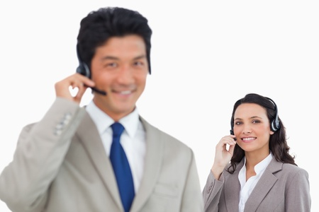 Young call center team against a white background photo