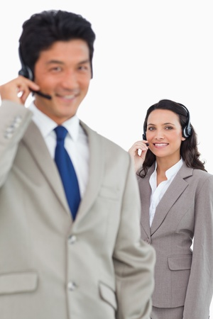Smiling customer support employees against a white background Stock Photo - 13615907