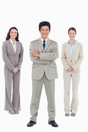 Smiling businessman with his staff behind him against a white background Stock Photo - 13605064