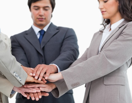 salespeople: Hands of salespeople together against a white background