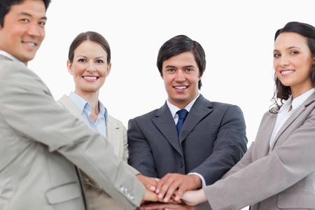 Young salesteam motivating each other against a white background Stock Photo - 13616175
