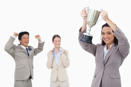 Smiling businesswoman holding cup against a white background photo