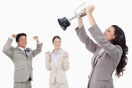 Successful businesswoman holding cup against a white background photo