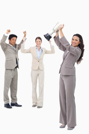 Successful tradeswoman holding cup against a white background Stock Photo - 13603792