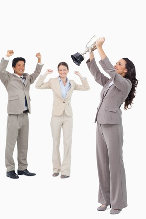 Victorious businesswoman with cup against a white background photo