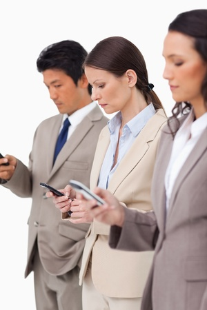 Group of businesspeople with their cellphones against a white background Stock Photo - 13616076