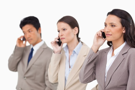 Businesspeople on the phone against a white background photo