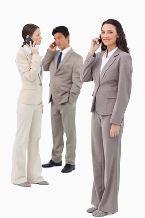 Businesspeople on their phones against a white background photo
