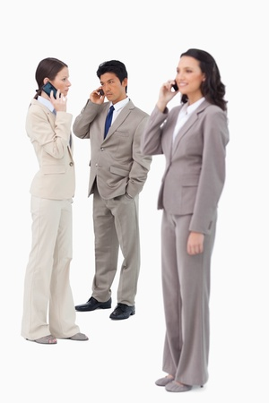 Salespeople on their cellphones against a white background photo