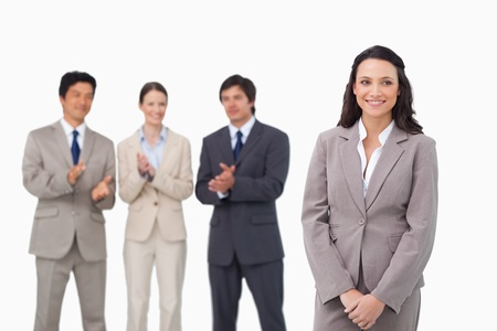 Businesswoman getting applause by colleagues against a white background photo