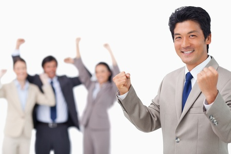 Successful businessman getting celebrated by colleagues against a white background photo