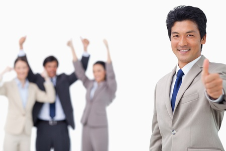 Businessman giving thumb up white getting celebrated against a white background photo