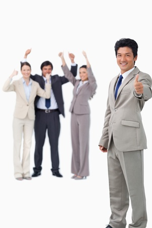 Salesman giving thumb up while getting celebrated against a white background photo