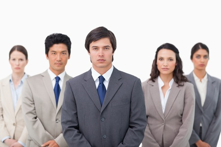 Serious salesteam standing together against a white background Stock Photo - 13615606