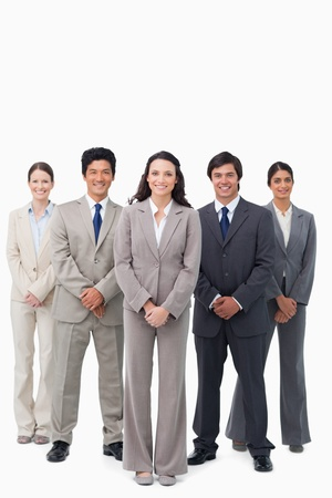 Smiling tradeswoman standing with her team against a white background Stock Photo - 13607124
