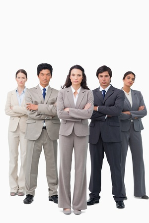 Serious businessteam standing with arms folded against a white background Stock Photo - 13607076
