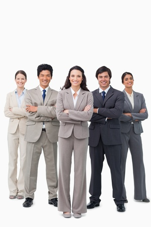 Smiling businessteam standing with arms folded against a white background Stock Photo - 13607074