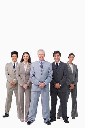 Smiling mature salesman standing together with his team against a white background photo