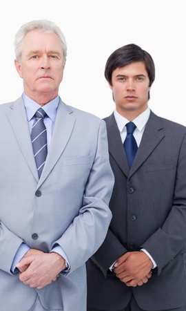 Mature businessman with his colleague against a white background Stock Photo - 13608589
