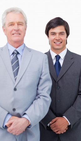 Young salesman with his mentor against a white background photo