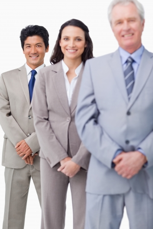 salespeople: Young salespeople together with mentor against a white background Stock Photo