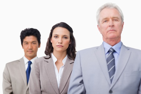 Mature businessman standing with colleagues against a white background Stock Photo - 13609651