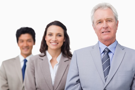 Senior salesman with his team against a white background photo