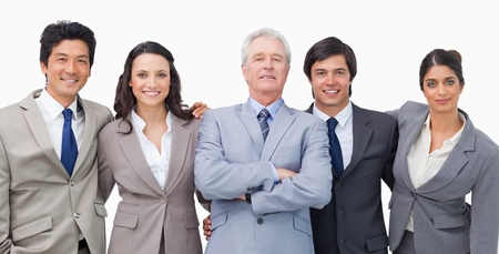 Smiling young businessteam with their mentor against a white background photo