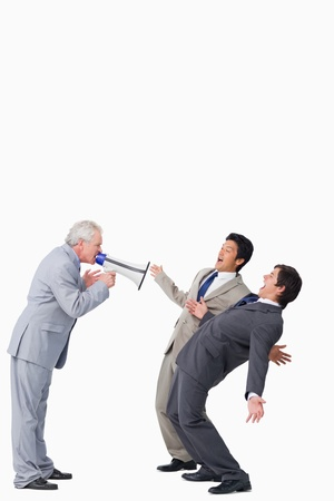 Mature salesman with megaphone yelling at his employees against a white background photo