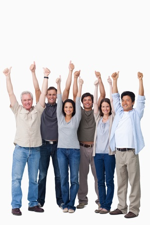 excited woman: Smiling group of friends giving thumbs up against a white background