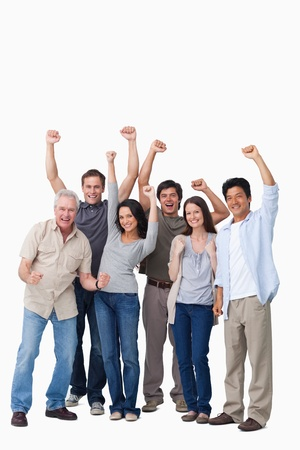 Cheering group of people against a white background photo