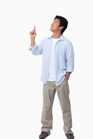 Male pointing and looking up against a white background Stock Photo - 13601798