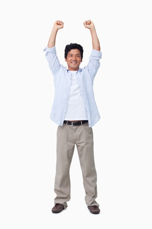 arms raised: Cheering male with arms up against a white background Stock Photo