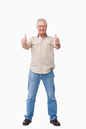 Mature male giving thumbs up against a white background photo