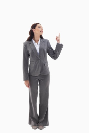 19's: Businesswoman presenting a product on the top against white background Stock Photo