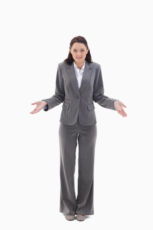 Businesswoman clueless against white background photo
