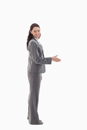 Profile of businesswoman smiling and shaking hands photo